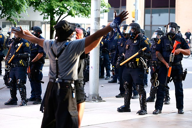George Floyd protesters clash with police near the intersection of Centre and Negley avenues following a peaceful demonstration in East Liberty on Mon., June 1, 2020. - CP PHOTO: JARED WICKERHAM
