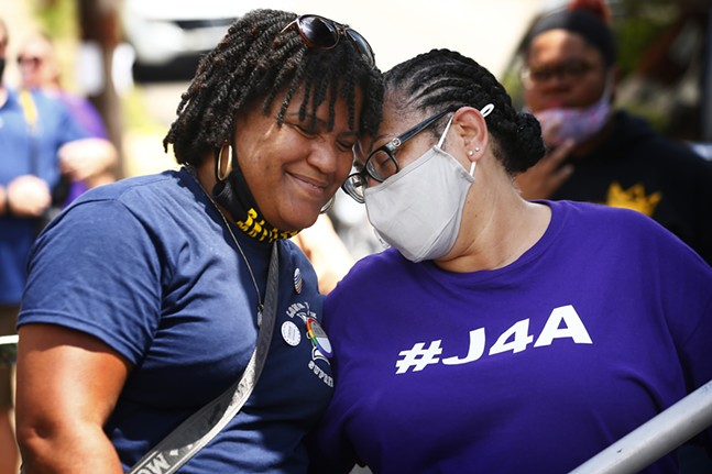Danielle Brown, mother of Marquis Brown who died in his dorm room at Duquesne University, shares a moment with Michelle Kenney, mother of Antwon Rose II following her speech. - CP PHOTO: JARED WICKERHAM
