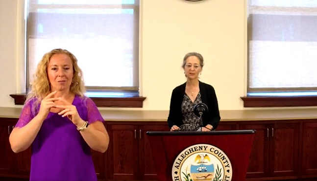 Dr. Debra Bogen (right) with interpreter in foreground - SCREENSHOT TAKEN FROM FACEBOOK