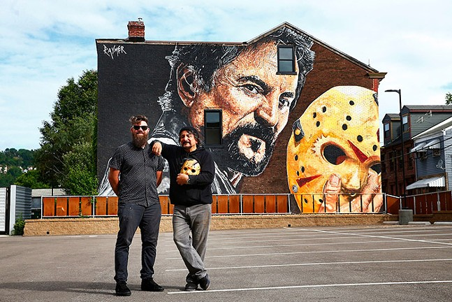 Mural artist Jeremy Raymer and Tom Savini in front of the mural - CP PHOTO: JARED WICKERHAM