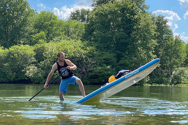 Jared Wickerham balancing on a stand-up paddleboard at Moraine State Park in Portersville, Pa. - PHOTO: RICHARD PALAGALLO