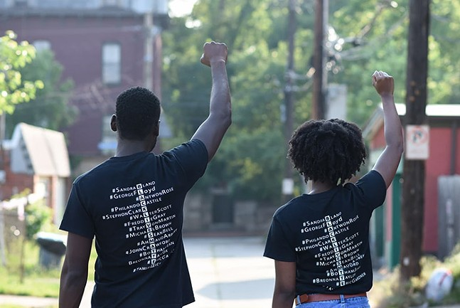 Moya Omololu and Amina Jones modeling Omololu's Black Lives Matter T-shirt design - ©SARAH BADER