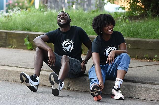 Moya Omololu and Amina Jones modeling Omololu's Black Lives Matter T-shirt design - ©SARAH BADER