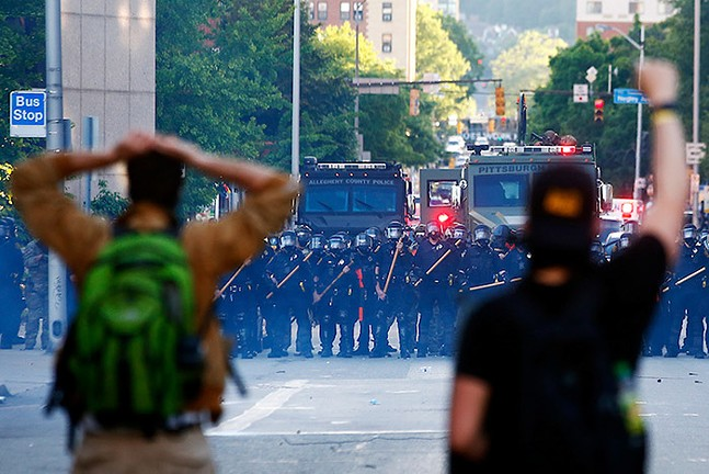 George Floyd protesters clash with police and SWAT near the intersection of Centre and Negley avenues following a peaceful protest in East Liberty on Mon., June 1, 2020 - CP PHOTO: JARED WICKERHAM