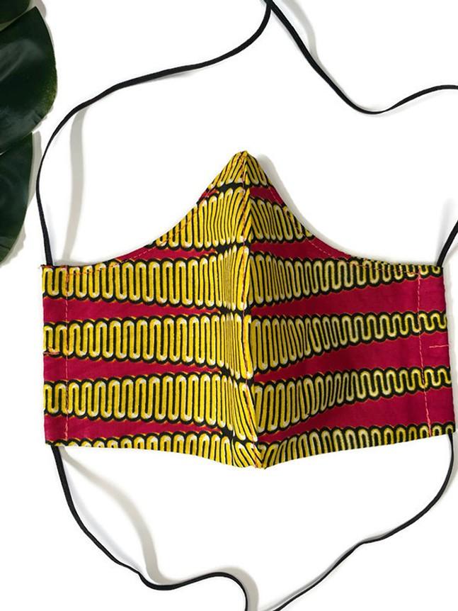 Yellow and Pink Wax Print Mask with filter pocket - PHOTO: BAIYINAH BROOKINS
