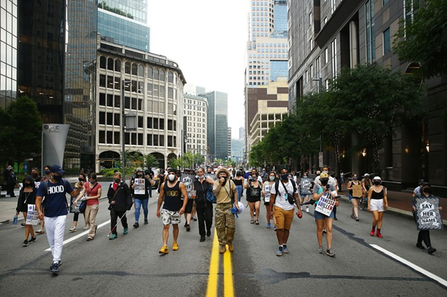 Brittney Chantele leads protesters through Liberty Avenue. - CP PHOTO: JARED WICKERHAM