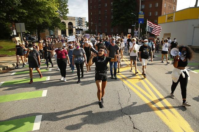 Jalina McClarin leads chants through the East Liberty neighborhood on Mon., July 13, 2020. - CP PHOTO: JARED WICKERHAM