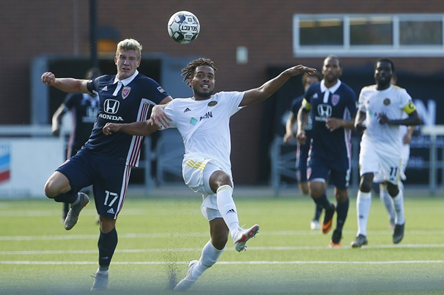 Thomas Vancaeyezeele #17 of the Pittsburgh Riverhounds fights for possession of a ball against Nick Moon #17 of Indy Eleven in the first half. - CP PHOTO: JARED WICKERHAM
