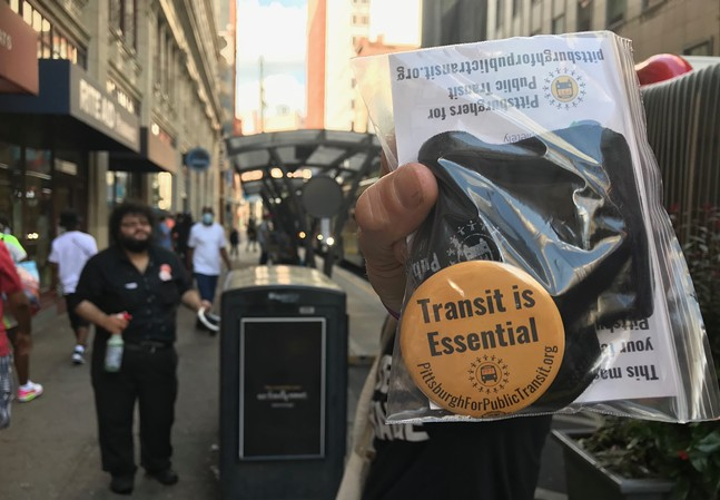 A mask and button distributed today in Downtown Pittsburgh - CP PHOTO: RYAN DETO