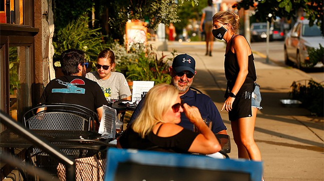 Alexa Namestnik waits on tables outside of Lot 17 in Bloomfield on Tue., July 21. - CP PHOTO: JARED WICKERHAM