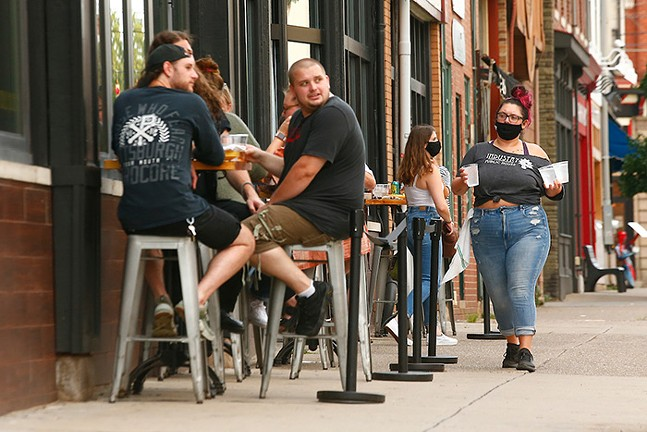 Patrons dine outside of Industry Public House in Lawrenceville on Tue., July 21. - CP PHOTO: JARED WICKERHAM