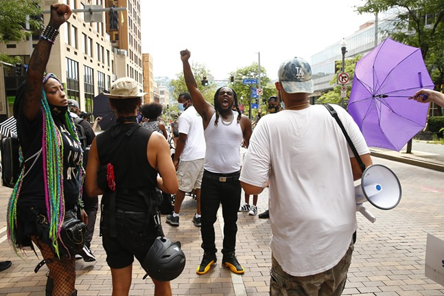 Local rapper argues with protest organizers while trying to shoot a music video - CP PHOTO: JARED WICKERHAM