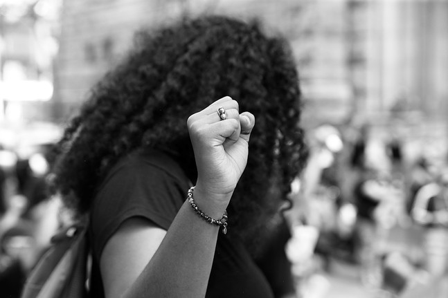 A protester takes part in a Black youth-led Civil Saturdays demonstration in Downtown Pittsburgh on Sat., July 4, 2020 - CP PHOTO: JARED WICKERHAM