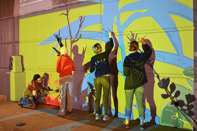 Previous public art by Riverlife: mural painters under the Fort Duquesne Bridge in 2015 - PHOTO: COURTESY OF RIVERLIFE