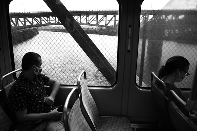 Riders pass over the Monongahela River from Station Square to First Avenue. - CP PHOTO: JARED WICKERHAM