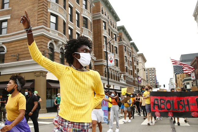 Black, Young, and Educated co-founder, Nicholas Anglin, marches along Forbes Avenue in Oakland. - CP PHOTO: JARED WICKERHAM