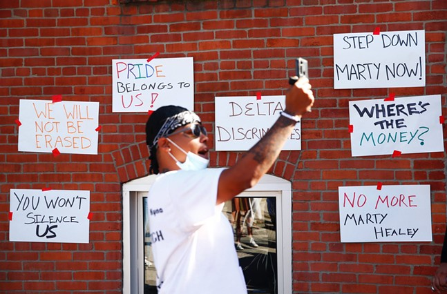 Black trans rights activists march against Pittsburgh's Delta Foundation in the South Side on Wed., Aug. 19, 2020. - CP PHOTO: JARED WICKERHAM