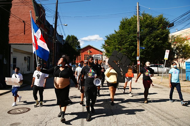 Protesters march through the South Side in protest to the Delta Foundation. - CP PHOTO: JARED WICKERHAM