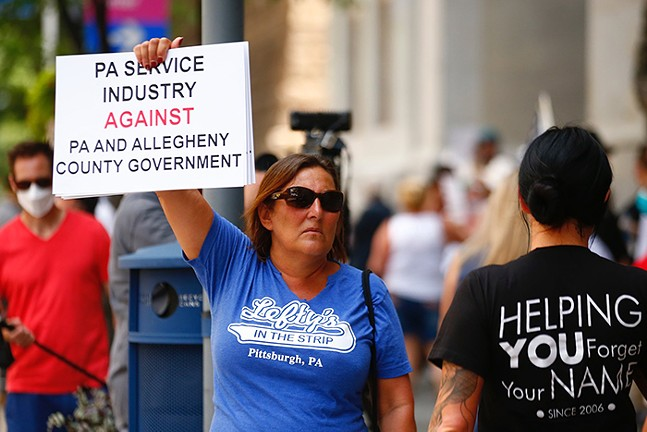 Lefty's worker at a protest in July in Downtown Pittsburgh - CP PHOTO: JARED WICKERHAM