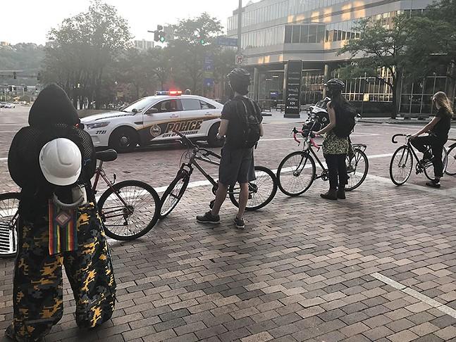 "Bike marshals on Grant Street during the ""F.J.E Wednesdays"" rally - CP PHOTO: RYAN DETO"