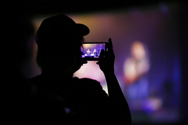An audience member takes a photo with their cell phone of the concert. - CP PHOTO: JARED WICKERHAM