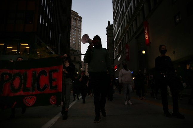 Trans YOUniting marches during a protest through downtown on Thu., Oct. 8, 2020 - CP PHOTO: JARED WICKERHAM