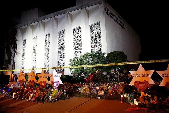 Star of David memorials, laid with flowers at the Tree of Life synagogue two days after a mass shooting in Pittsburgh in October 2018 - CP PHOTO: JARED WICKERHAM