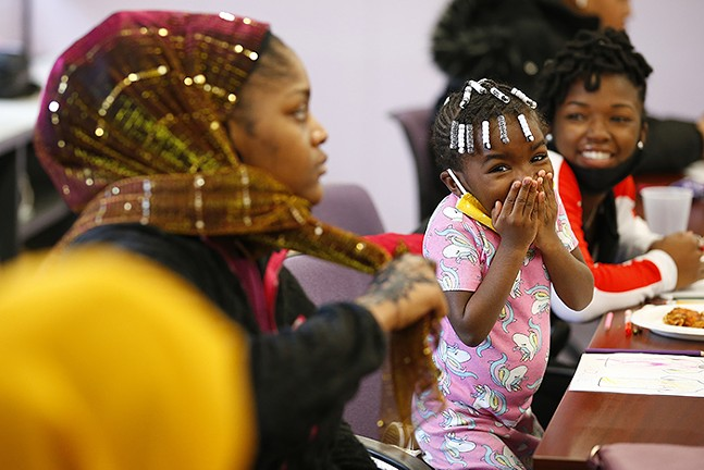 Nia Caroline, 3, reacts while playing Uno during Gwen's Girls young adult program - CP PHOTO: JARED WICKERHAM