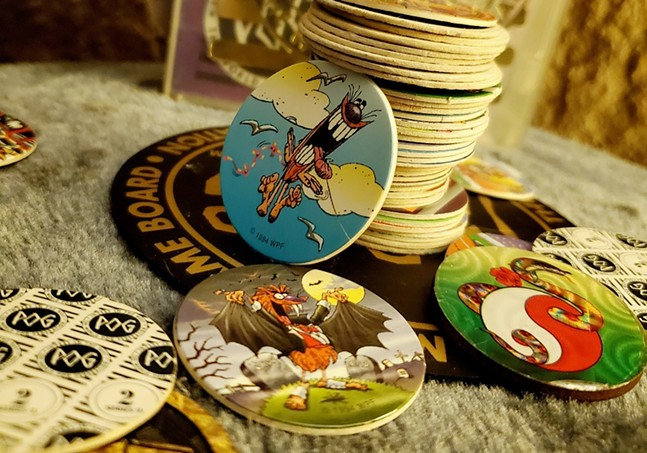 Photo of a Pog collection submitted to The Warhol's Gen-Z Time Capsule - THE ANDY WARHOL MUSEUM