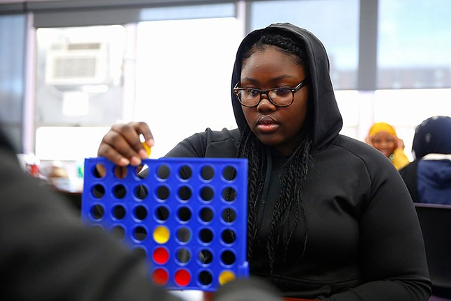 A member of Gwen's Girls young adult program plays ConnectFour. - CP PHOTO: JARED WICKERHAM
