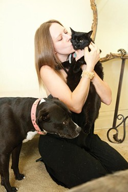 Heather Long kisses her one-eyed rescue cat named Frankencat - PHOTO BY HEATHER MULL