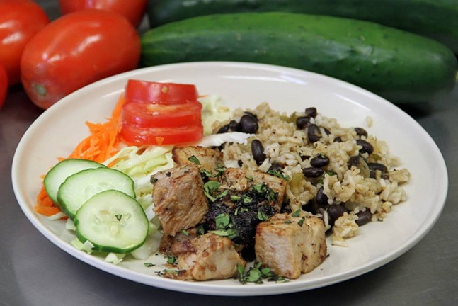 Lechon asado, slow roasted pork marinated in mojo sauce - PHOTO COURTESY OF CONFLICT KITCHEN