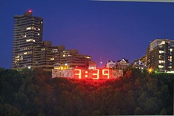 On the clock: Lamar Advertising's neon Mount Washington sign - PHOTO BY HEATER MULL