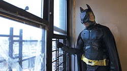 """The Dark Knight,"" in a suit made of cardboard and yoga mats, surveys Gotham."