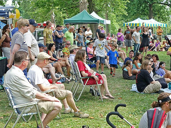 Festival-goers at the outdoor park stage in 2014 - PHOTO COURTESY OF RANDY STROTHMAN