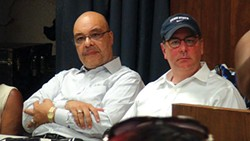 City Councilor Ricky Burgess and Mayor Bill Peduto listen to residents' concerns at a July 18 public meeting - PHOTO BY AARON WARNICK