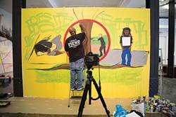 Alphonso Sloan works on his painting at SPACE. - PHOTO COURTESY OF LAILA ARCHULETA