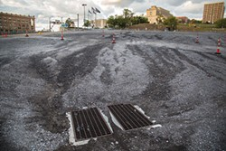 Grounds for discussion: The former Civic Arena site, now a parking lot. - PHOTO BY THEO SCHWARZ