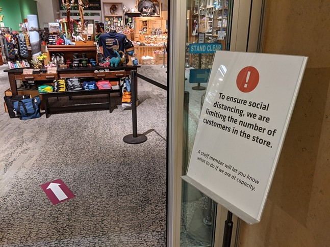 Social distancing signage outside the Carnegie Museum of Natural History gift shop - CP PHOTO: AMANDA WALTZ