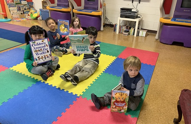 Local children show off their Books for Change books - UNIVERSITY OF PITTSBURGH OFFICE OF CHILD DEVELOPMENT