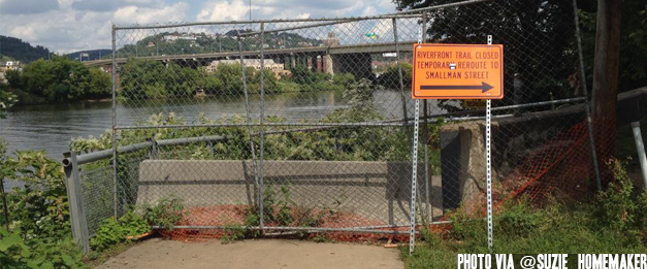 Fence blocking the entrance to the trail along the Allegheny River at 11th Street. - PHOTO COURTESY OF BIKEPGH.ORG
