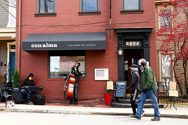 Howie Alexander and Tony DePaolis play in front of Con Alma in Shadyside in May 2020. - CP PHOTO: JARED WICKERHAM