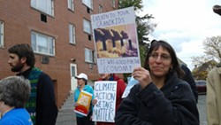 """Anita Weingarten, of Penn Hills, marched to U.S. Rep. Keith Rothfus' office carrying  a sign of smokestacks, reading """"Explain to our children it was good for the economy."""" - PHOTO BY ASHLEY MURRAY"""