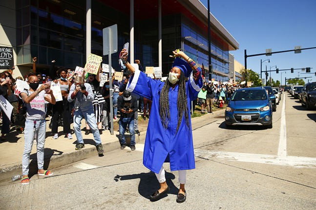 Re-Del Greer, who graduated virtually from Perry, is congratulated by the George Floyd protestors in front of Target in the East Liberty neighborhood on Mon., June 1, 2020. - CP PHOTO: JARED WICKERHAM