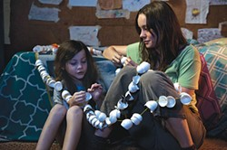 World-building: Jack (Jacob Tremblay) and Ma (Brie Larson) work on their egg snake.