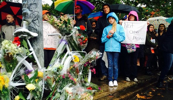 Morners attending the vigil of Susan Hicks, who died in October after being crushed in between two cars on Forbes Avenue in Oakland. - PHOTO COURTESY OF BIKE PGH