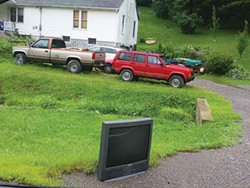 A TV awaits trash pickup that won't come. - PHOTO BY CHARLIE DEITCH