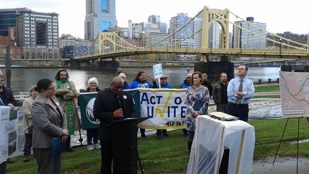Rev. Rodney Lyde, of Homewood's Baptist Temple Church, speaking at a demonstration against ALCOSAN's planned construction along riverfronts - PHOTO BY ASHLEY MURRAY