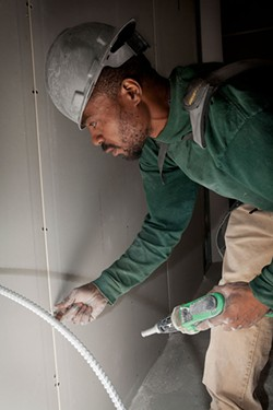 Jermaine Butler, of Homewood, completed the CEA construction training program three years ago and now works carpentry jobs at Ma'at Construction Group. - PHOTO BY HEATHER MULL