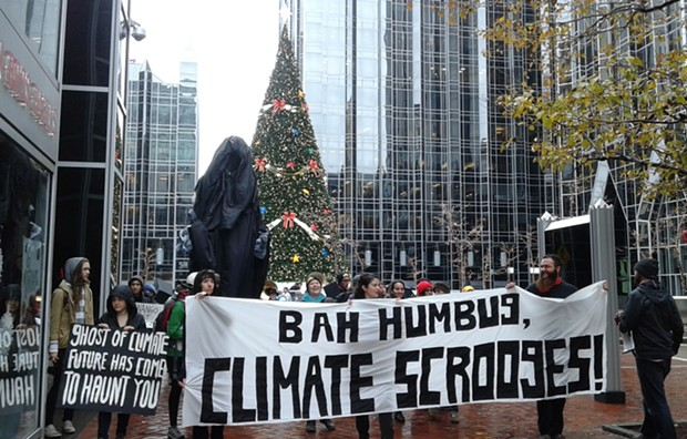 """Protesters visited PPG Industries to deliver """"lump of coal"""" from the """"ghost of climate future"""" to executives. - PHOTO BY ASHLEY MURRAY"""